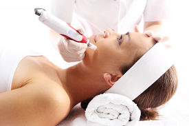 stock photo of wrinkled face  - Beautician performs a needle mesotherapy treatment on a woman - JPG