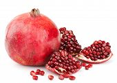 foto of whole-grain  - whole pomegranate with pieces and grains isolated on white background - JPG