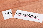 picture of disadvantage  - Two pieces of white paper with the word disadvantage turned into advantage - JPG