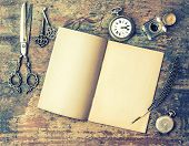 stock photo of feathers  - Open book and antique writing tools on wooden table - JPG