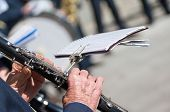 foto of clarinet  - man plays the clarinet during a religious cerimony - JPG