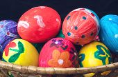picture of easter basket eggs  - Easter eggs lying in a basket - JPG