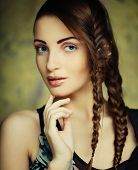 stock photo of braids  - close up portrait of beautiful young blonde woman with creative braids hairdo  - JPG
