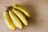 pic of bunch bananas  - bunch of ripe bananas on wooden background - JPG