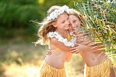 pic of sisters  - portrait of two sisters twins in tropical style - JPG