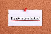 pic of transformation  - Transform your thinking text paper is pinned on cork - JPG