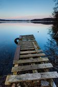 stock photo of pier a lake  - Small pier on lake long exposure photo - JPG
