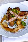 stock photo of veal  - Veal shallots and potatoes on a plate - JPG