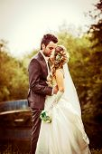 foto of old bridge  - Wedding couple outdoor with lake an old bridge on background - JPG