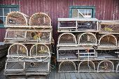 foto of trap  - Stacks of wooden lobster traps in North Rustico - JPG