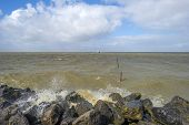 stock photo of barge  - Barge sailing in a stormy lake in spring - JPG