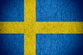 image of sweden flag  - flag of Sweden or Swedish banner on rough pattern texture - JPG