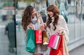 pic of in front  - Two attractive young women shopping together - JPG