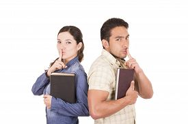 foto of shhh  - couple of cheerful happy attractive students holding book gesturing silence shhh isolated on white - JPG