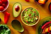 stock photo of poblano  - Mexican food mixed guacamole chili sauce avocado tomatoes and coriander - JPG
