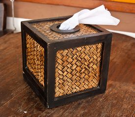 image of tissue box  - Tissue box on a wooden table in the resort - JPG