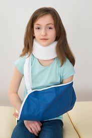 foto of neck brace  - Portrait Of Girl Wearing Neck Brace And Arm Sling - JPG