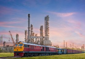 pic of electric station  - Industrial plant power station and train on the sun light - JPG