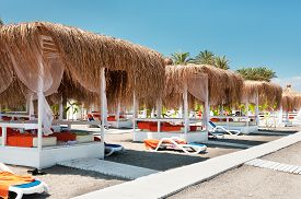 foto of canopy  - Canopies from the sun on a beach in Turkey - JPG