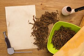 pic of tobacco-pipe  - Tobacco for pipe and pipe smoker tools and scraper - JPG