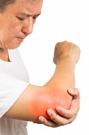 stock photo of tennis elbow  - Matured man suffering from sore and painful elbow embraces elbow - JPG