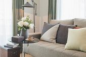 Vase Of Flower On Round Glass Table With Set Of Sofa In Modern Living Room poster