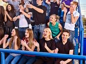 Постер, плакат: Fans cheering in stadium Group people wait your favorite team and worry on tribunes Youth support