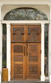 Building Doorway With A Weathered Wooden Door poster