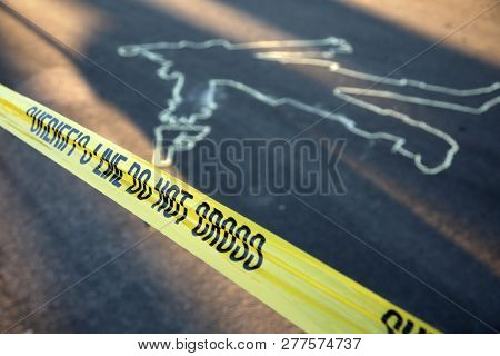 poster of Crime Scene. Chalk Outline. KILLER CLOWN Chalk Outline in the street.  Clown with hand gun chalk out