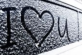 I Love You Heart Symbol On Frozen Window Of The Car. Shape Of Heart Drawn On Snow On Front Window Of poster