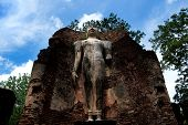 Wat Phra Si Lriyabot With Buddha Statues Historical Park In Kamphaeng Phet, Thailand (a Part Of The poster