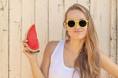 Summertime In Garden. Young Beautiful And Smiling Woman In Garden With Juicy Watermelon. poster