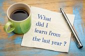 What did I  learn from the last year? Handwriting on a napkin with a cup of espresso coffee poster