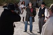 stock photo of gunfights  - A gunfight is about to begin in an old western town - JPG