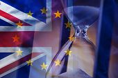 Closeup Elegant Sandglass Counting Down Time To Brexit On Background Of Overlapped Flags Of Great Br poster