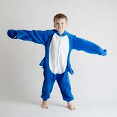 Cheerful Little Boy Posing On A White Background In Pajamas, Blue Shark Costume poster