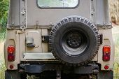 Old Suv Close-up With Spare Wheel, Back View poster