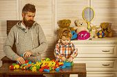 Father Small Child Play With Constructor. Happy Childhood. Care And Development. Little Boy Together poster