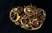 A Scrap Of Gold. Old And Broken Jewelry, Watches Of Gold And Gold-plated On A Dark Background. poster
