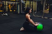 Muscular Woman Doing Intense Core Workout In Gym. Strong Female Doing Core Exercise On Fitness Mat W poster