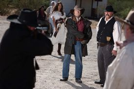 pic of gunfights  - A gunfight is about to begin in an old western town - JPG