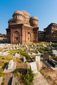 picture of empty tomb  - Graves surround the Tomb of Budshah a popular tourist attraction in Srinagar Kashmir India - JPG