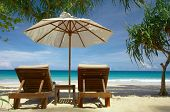 pic of sunny beach  - view of two chairs and white umbrella on the beach - JPG