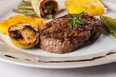 image of flambeau  - closeup of a steak with a rosemary leaf - JPG