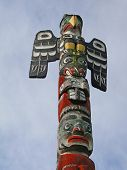 pic of indian totem pole  - Totem pole topped by thunderbird Thunderbird Park Victoria BC Canada - JPG