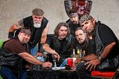 foto of gang  - Tough group of Caucasian biker gang members with weapons - JPG