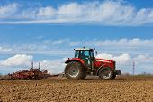 stock photo of plowed field  - Farmer plowing the field - JPG