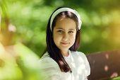 foto of communion  - Cute Little Girl with her First Communion Dress - JPG
