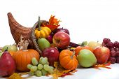 stock photo of cornucopia  - An overflowing cornucopia including pumpkins - JPG