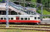stock photo of railcar  - Passenger train at a railway station at summer - JPG